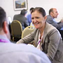 smiling woman in one-to-one discussion