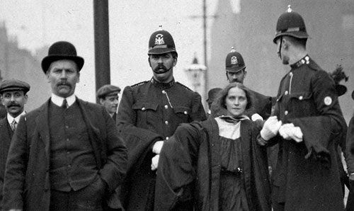 Historical photo of protester being escorted away by police
