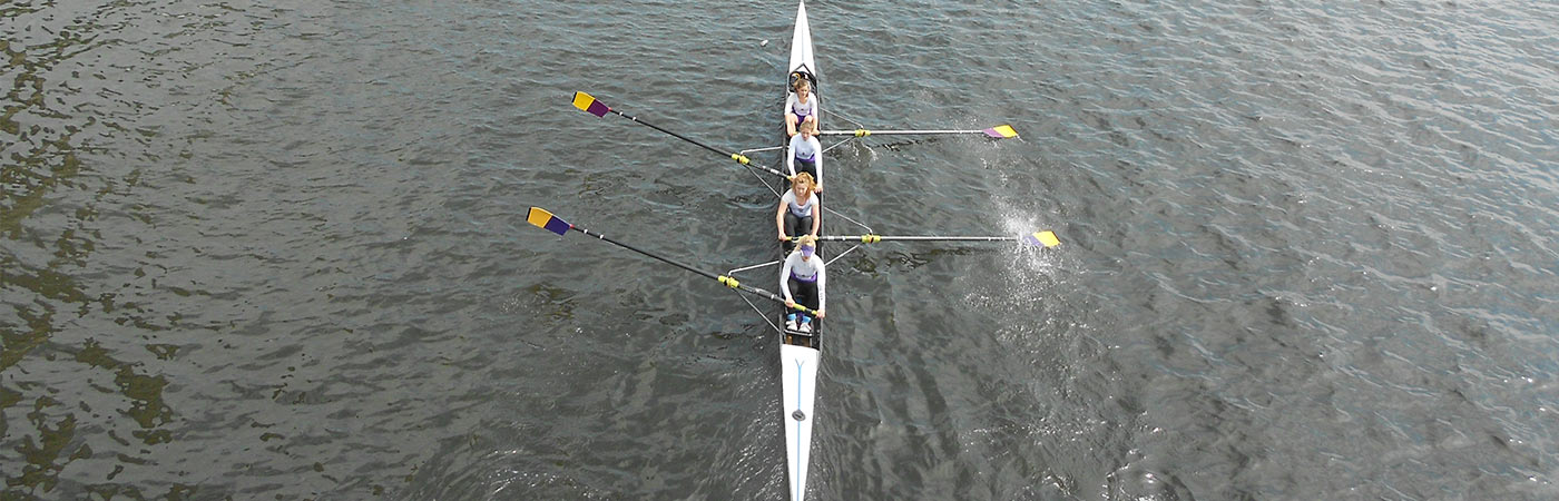 Students rowing in Salford Quays
