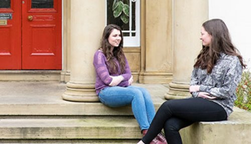 Students sat outside Ashburne Hall, residences