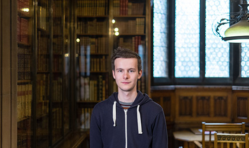 Portrait of student in the John Rylands library