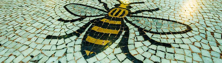 Manchester bee logo on tiles