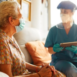 A female doctor visits a senior woman at the nursing home. iStock photo