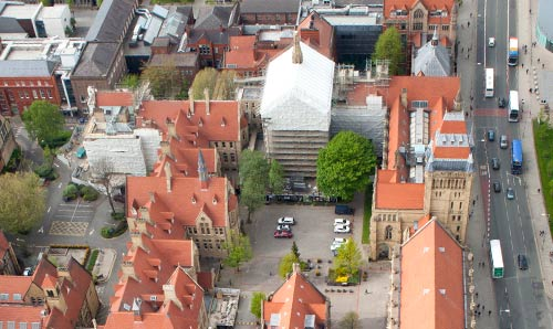 Aerial shot of building under wraps while conservation work takes place