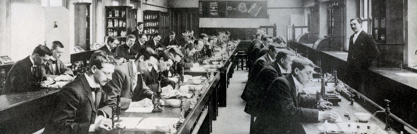 students working in pathology lab, 1900