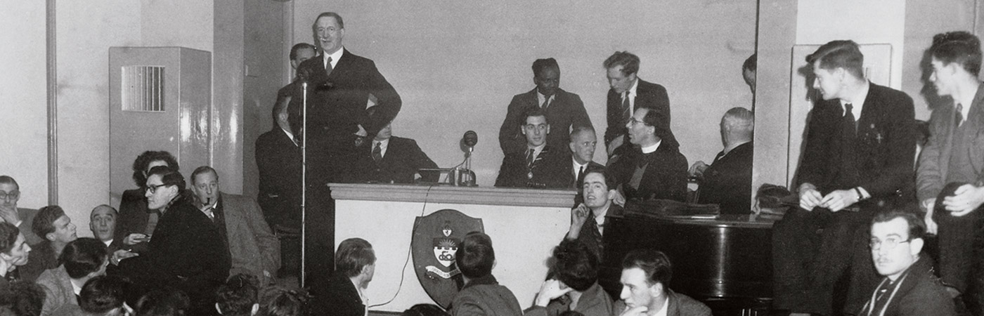 historical photo of students listening to speech given at the university