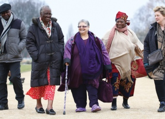 Group of elderly people walking in park