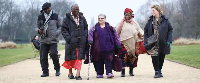 Group of elderly people walking in the park