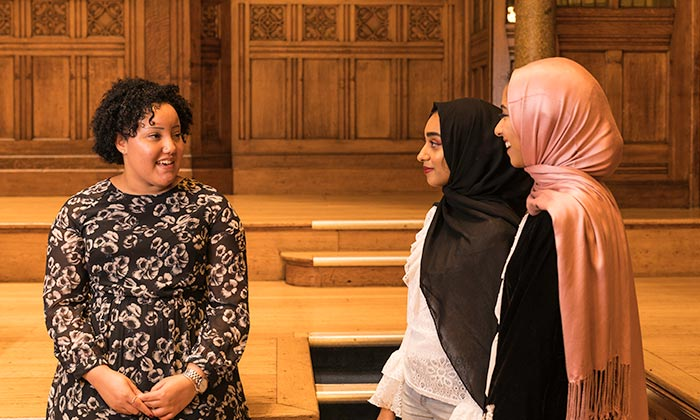 Letitia Budu talks with MAP students in the Whitworth Hall.