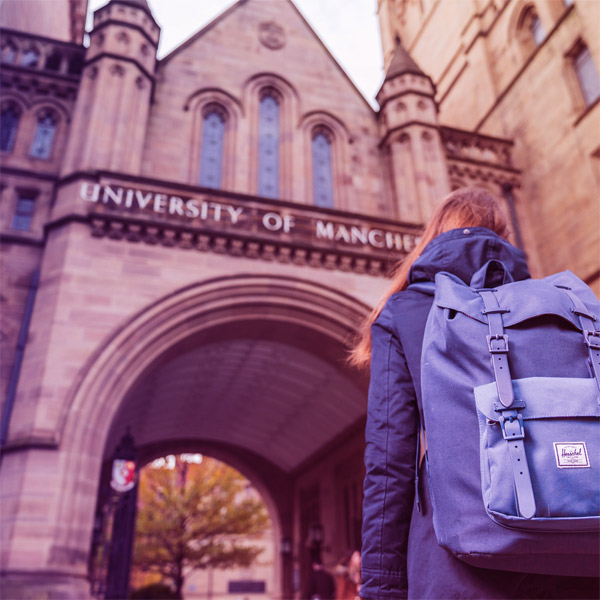 Image of student walking through the Whitworth Hall arch