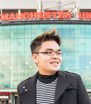 International student outside Manchester United football ground