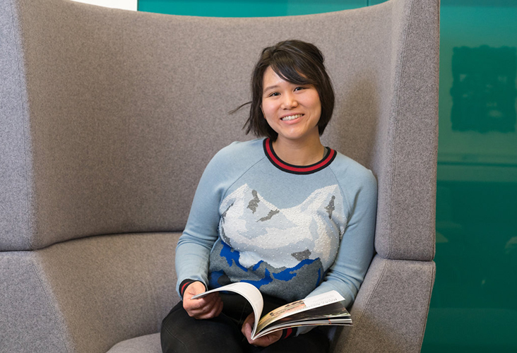 Postgraduate international student sat in study chair