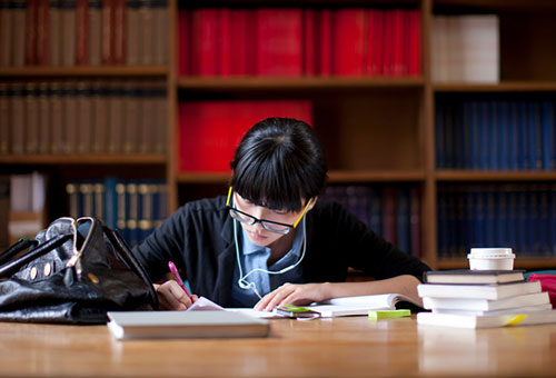 student sat in library