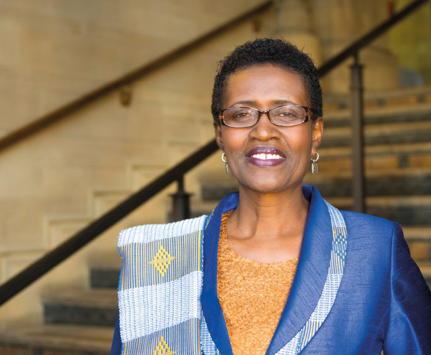 Winnie Byanyima standing in The University of Manchester's Whitworth Hall