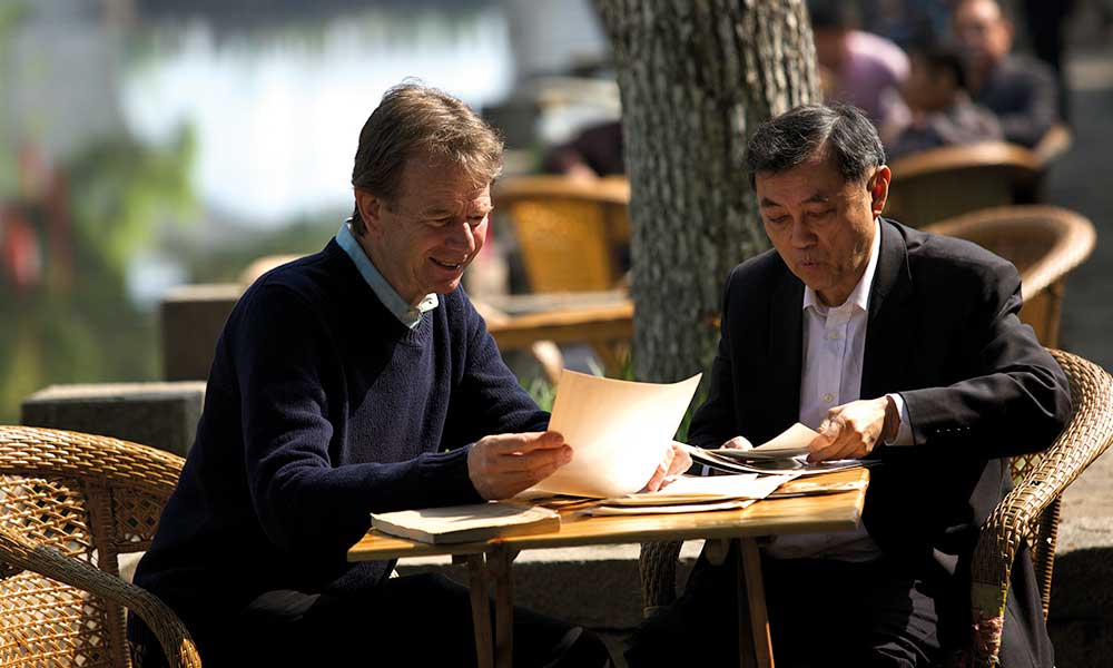 Talking to Frank Ching about his ancestors by the canal, Wuxi.