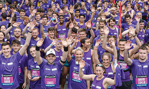 Thousands of staff, students and alumni together in a 'Purple