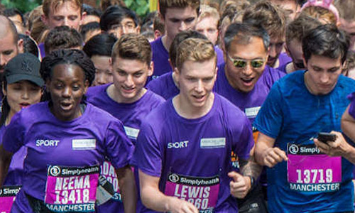 University staff running at the Great Manchester Run