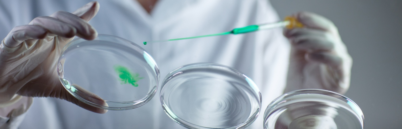 Green chemicals and pipette image - iStock fotografixx
