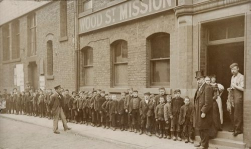 Children queuing outside of Wood Street Mission, Salford.