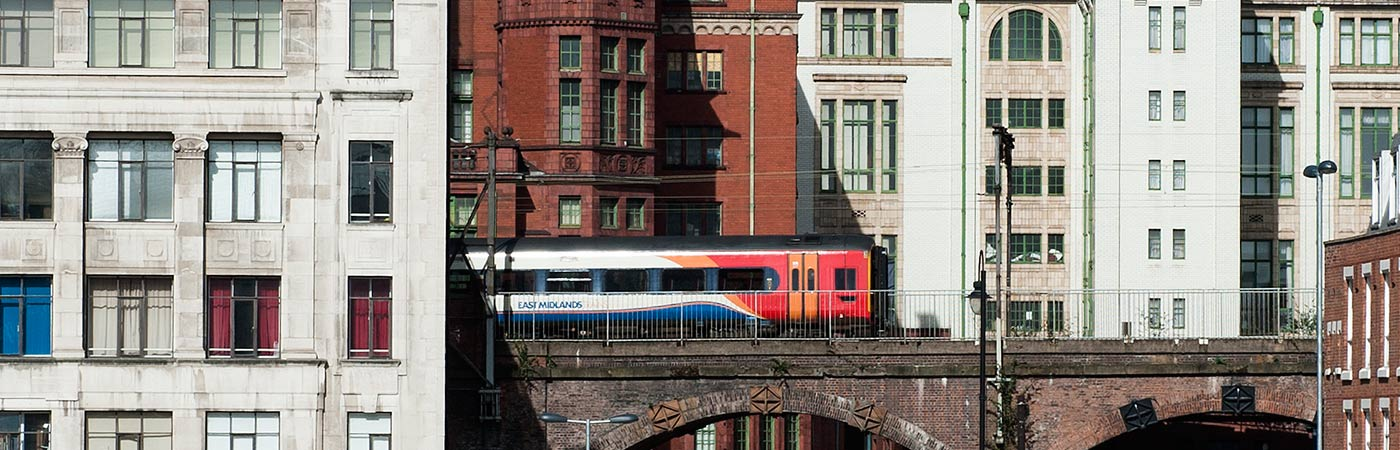 Train travelling through Manchester city centre