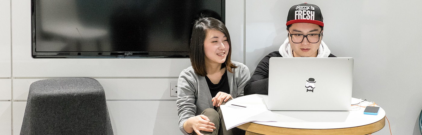 female and male student studying at computer in learning commons