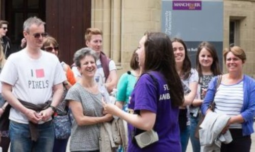 Student ambassador guides visitors at an open day at The University of Manchester.