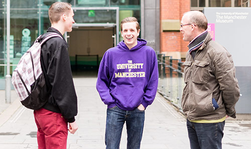 Father and son being shown around the university by student