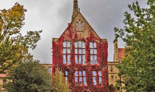John Owens Building covered in red ivy.