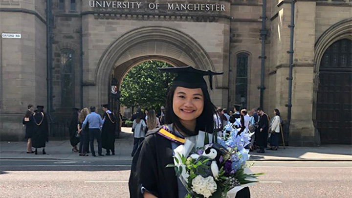 Amelia Huang's graduate photo outside Whitworth Hall.