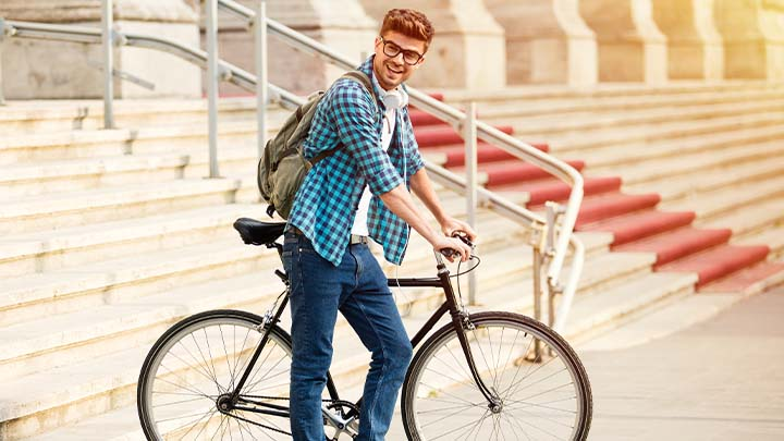 Male student on his bicycle