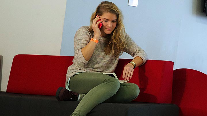 A student talking on the phone.