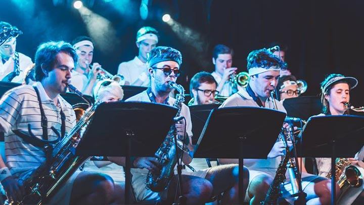 The UoM Big Band saxophonists performing in Hawiian shirts