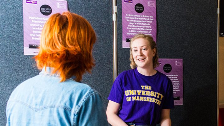 A student talking at an event stand